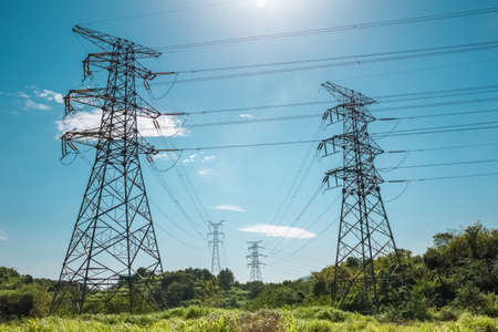 electricity grid: electricity pylon against a blue sky , power transmission background Stock Photo