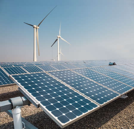 solar panels: solar panels and wind power farm , new energy background Stock Photo