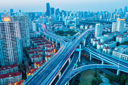 junction of city road at dusk in prosperous city of shanghai , China photo