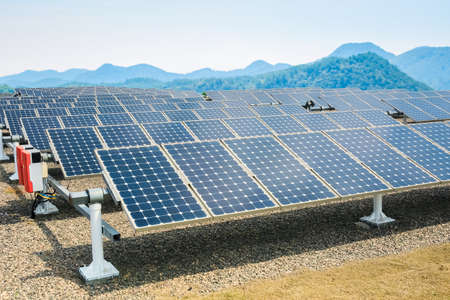 solar power station: solar energy panels and sunny valley,renewable energy background