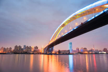 steel arch bridge: shanghai lupu bridge at night ,it is the worlds second longest steel arch bridge.