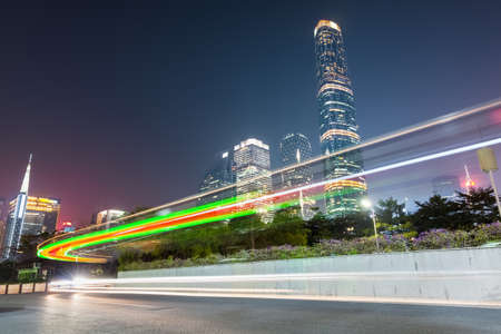 light trails on the city road in guangzhou central business district photo