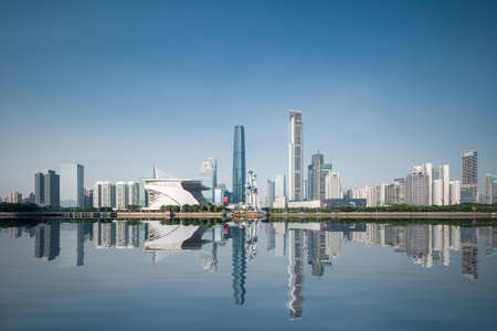 pearl background: City skyline and reflection in Guangzhou , beautiful pearl river new town at daytime ,China