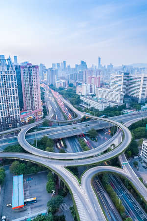 highway interchange: a highway interchange in guangzhou at dusk with vehicles motion blur Stock Photo