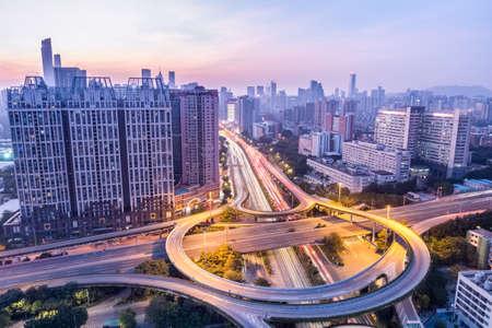 huangpu: guangzhou huangpu interchange in twilight with city skyline