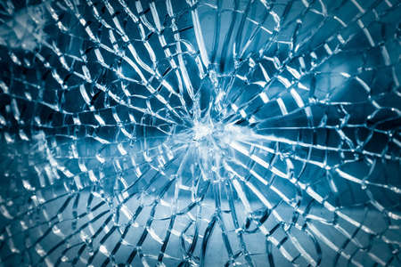 broken toughened glass closeup , background of glass was smashed