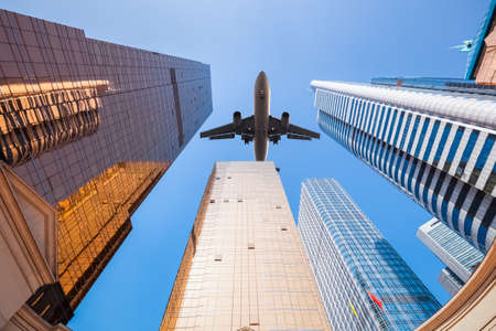 upward view of airplane and modern building background in guangzhou