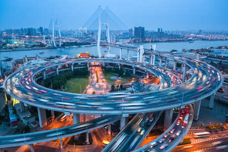 shanghai nanpu bridge at dusk ,  busy city traffic closeup