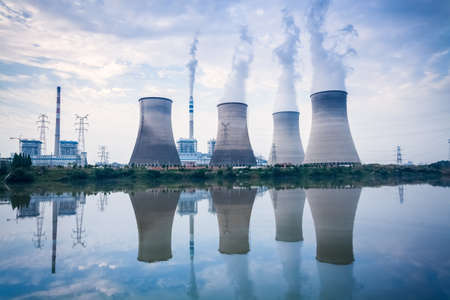 coal-fired power plant , cooling towers and river surface reflection , jiangxi , China 新闻类图片