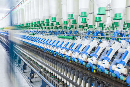 processing speed: cotton spinning machinery , high speed operation with motion blur Stock Photo