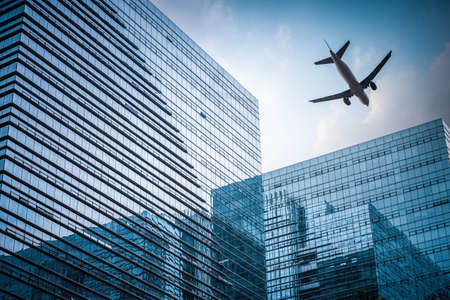 building exterior: futuristic glass building with airplane , abstract reflection in the geometry space Editorial
