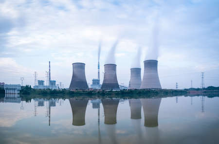 cooling tower: power plant in riverside , a row of cooling tower with the reflection Editorial