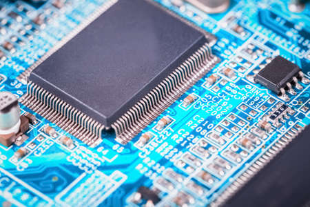 microelectronics: computer motherboard closeup ,  microelectronics and semiconductors background Editorial