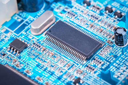 microelectronics: computer motherboard closeup , electronic board of microelectronics and semiconductors background