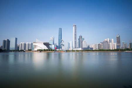 density: guangzhou skyline on pearl riverside , long exposure time of neutral density grey filter in daytime Stock Photo