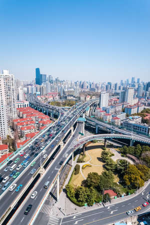viaducts: city interchange of viaducts on traffic rush hour in shanghai