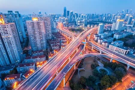 aerial view city: city interchange at nightfall in shanghai, modern transport infrastructure background Stock Photo