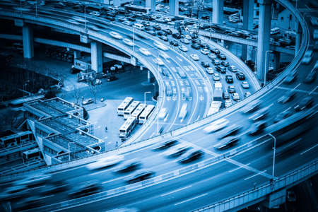 infrastructure buildings: heavy traffic closeup, vehicles motion blur on viaduct with blue tone