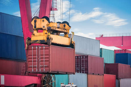 unloading: industrial crane loading and unloading and cargo containers closeup, modern logistics background