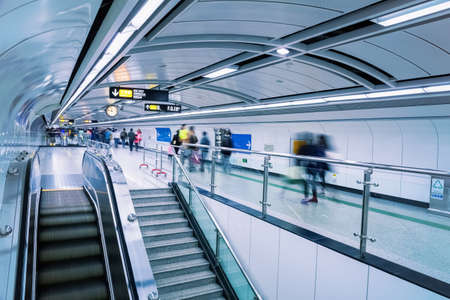 blur subway: futuristic subway passage with commuters motion blur in guangzhou
