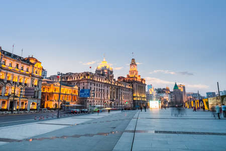 riverfront: delightful scenery of the bund in shanghai ,old buildings and riverfront boulevard at dusk