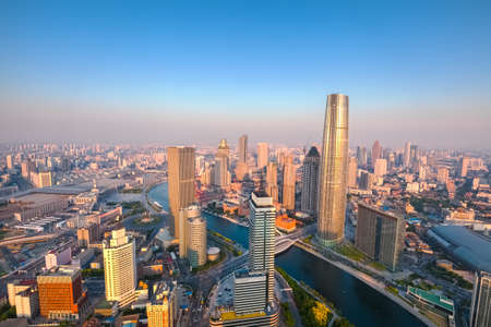 districts: aerial view of tianjin skyline at dusk, modern buildings in financial district ,China