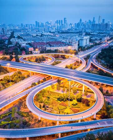 interchange: modern interchange road with city skyline in tianjin ,road transport background Stock Photo