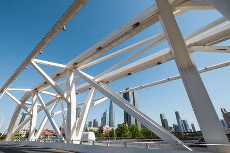 progression: Progression bridge in Tianjin against a blue sky