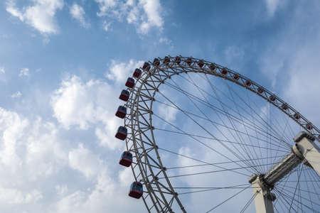 upward: upward view ferris wheel against a blue sky Editorial