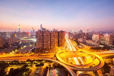 nightfall: interchange road with guangzhou skyline in nightfall