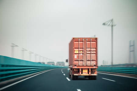 intermodal: container truck on the bridge with motion blur , modern logistics background