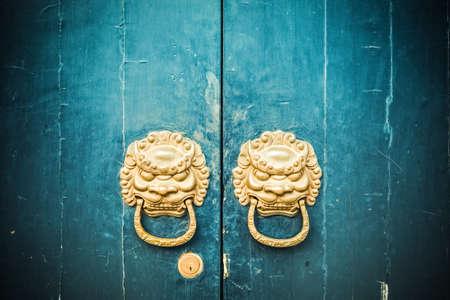 knocker: closeup of the antique oriental door knocker