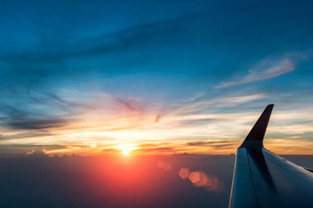 glorious sunset with plane wing in the air Stock Photo