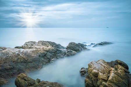 sea and rocks in early morning Фото со стока