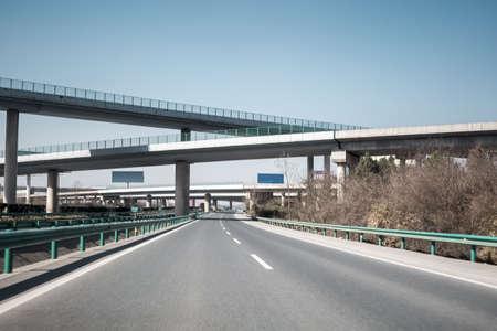 overpass: highway and transportation hub under the interchange overpass bridge