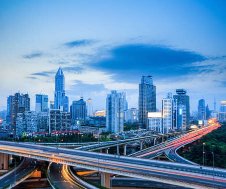 interchange: shanghai modern skyline with city interchange overpass in night falls Stock Photo