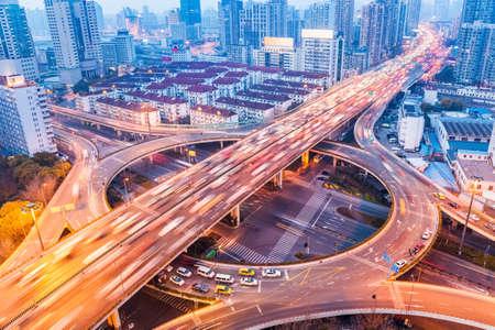 city interchange closeup at busy nightfall , shanghai, China Standard-Bild