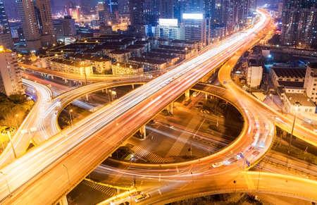 interchange: shanghai city interchange closeup at busy night Stock Photo
