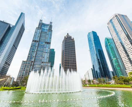 upward: city fountain with modern buildings in shanghai central greenland park, upward view Stock Photo