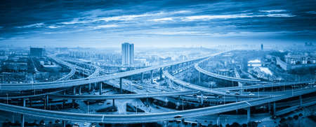city traffic: panoramic view of interchange overpass bridge in nanjing, blue tone