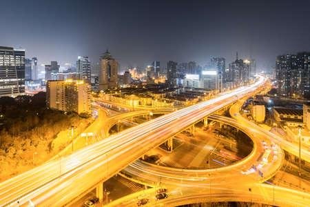 separation: urban grade separation bridge in shanghai at busy night Stock Photo