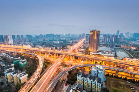 expressway: city interchange in nightfall, road junction of urban expressway background