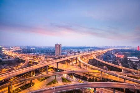 expressway: nanjing city interchange in nightfall, road junction of urban expressway background, China