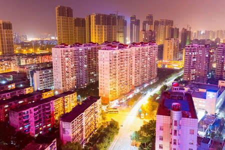 residential district: residential area with city street at night in wuhan , China