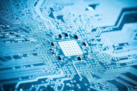printed: blue printed circuit board closeup , background of science and technology