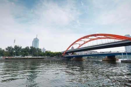 king kong: tianjin king kong bridge on the haihe river ,rainbow type steel structure of modern bridge Stock Photo