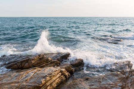 koh samet: water of thailand sea crushes in rocks of the koh samet islands shore.