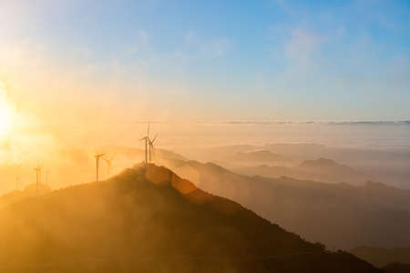 hubei province: wind turbines at sunrise on the top of jiugong mountain ,hubei province,China