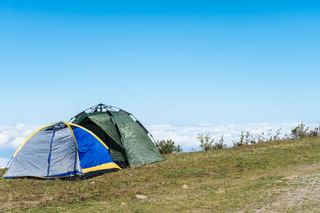 campsite: camping tents and the sea of clouds at jiugong mountain ,hubei province,China