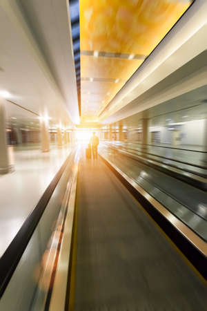 dynamic movement: moving escalator in airport lobby with motion blur , shanghai ,China